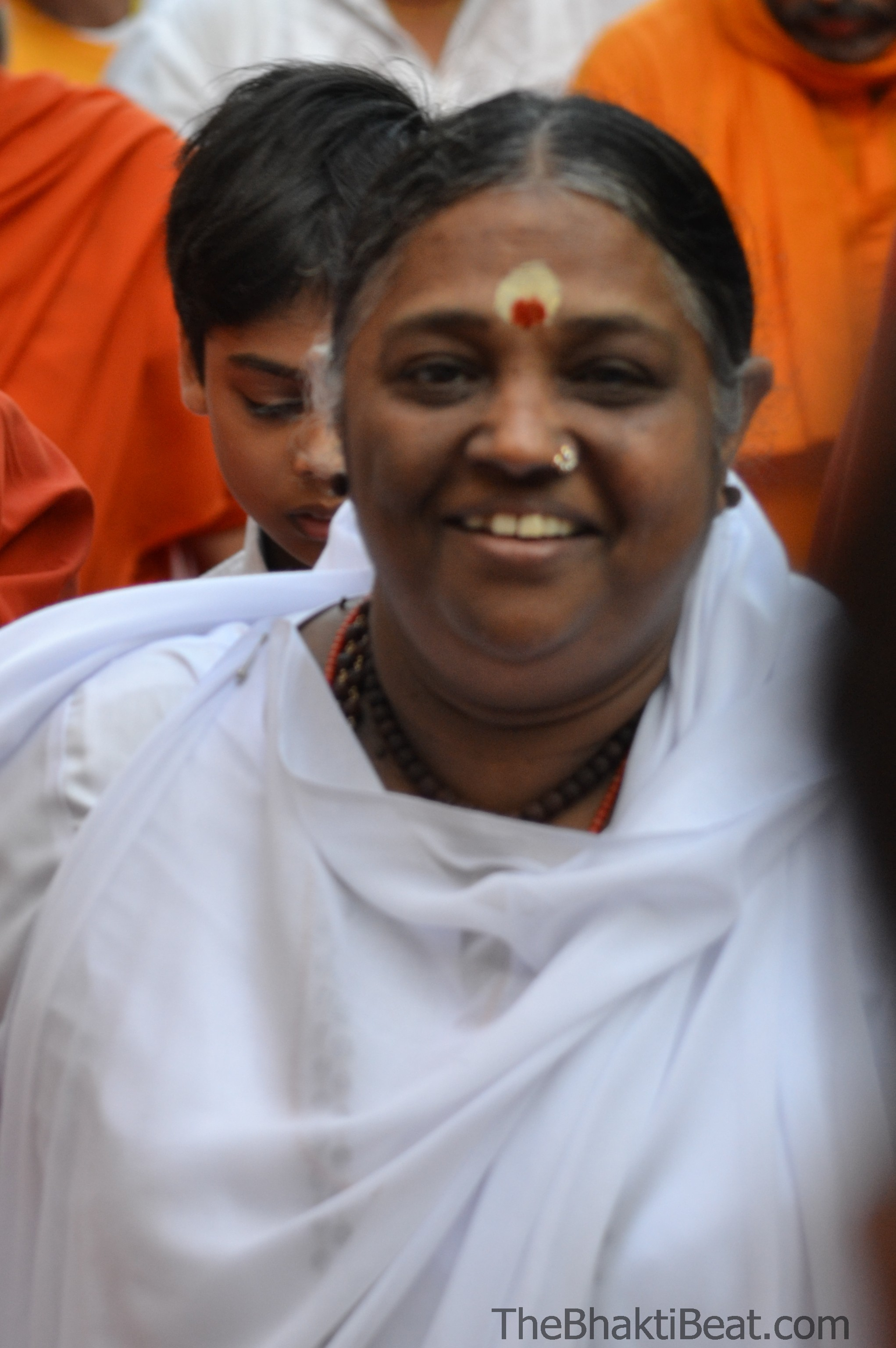 Amma graces with a glance. From TheBhaktiBeat.com